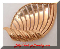 Trifari golden scrolling shell brooch
